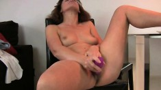 Naughty mature lady Inge uses a purple vibrator to satisfy her needs