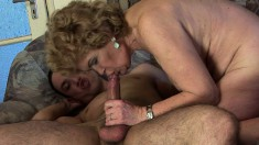 Chunky mature woman spreads her legs to take in a rock-hard wang