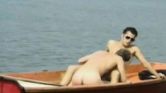 Two gorgeous gay studs satisfying their desires and needs on a boat