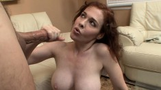 Stacked redhead milf Mae Victoria works her gifted hands on a big cock