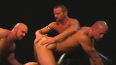 Three musclemen get down for a nasty round of cocksucking and fist fucking