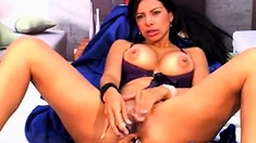 squirts in her own mouth